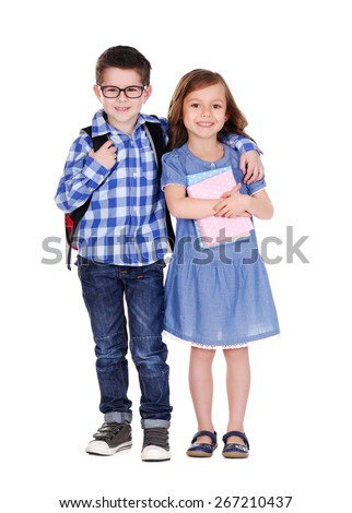 smiling schoolboy and the schoolgirl  full length portrait on white - stock photo