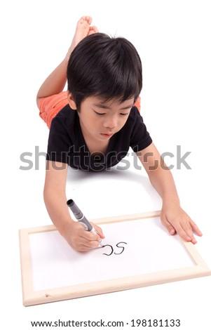 Smiling schoolboy writing whiteboard isolated on white background - stock photo