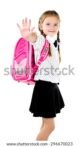 Smiling schoolgirl with backpack saying good bye isolated on a white background - stock photo