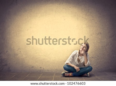 Smiling seated teenage girl - stock photo