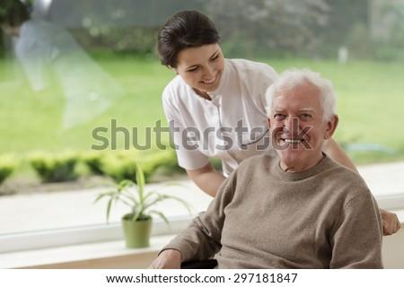 Smiling senior man staying in nursing home - stock photo