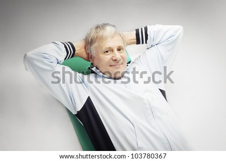 Smiling senior man wearing a sport suit - stock photo