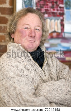 smiling senior middle age retired man with long hair - stock photo