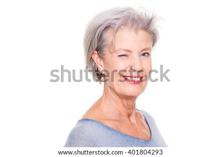 Smiling senior woman in front of white background - stock photo