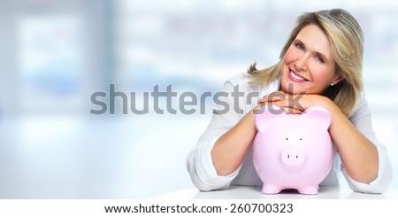 Smiling senior woman with piggy bank. Saving account. - stock photo