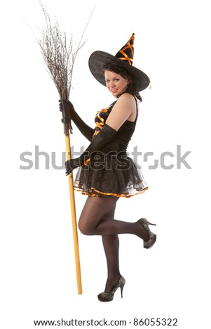 smiling sexy girl in Halloween witch with broom - stock photo