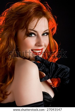 Smiling sexy woman with red hair and black gloves - stock photo