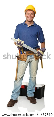 smiling standing handyman holding spirit level on white - stock photo