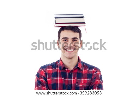Smiling student young man holding books on his head over white background. - stock photo