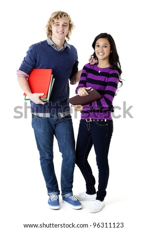 smiling students holding books - stock photo