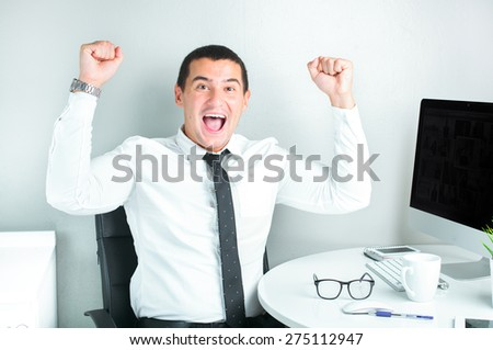 smiling successful businessman working at the office  - stock photo