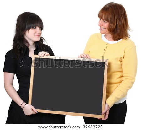 Smiling teacher and student holding chalkboard. - stock photo