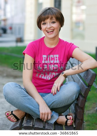 smiling teen girl on the bench - stock photo