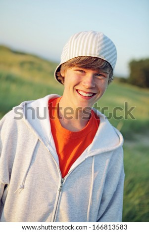 Smiling teen outdoors - stock photo