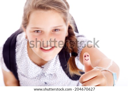 Smiling teen student showing thumbs up, isolated on white background - stock photo