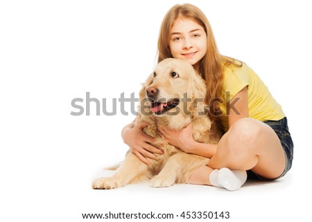 Smiling teenage girl sitting with Golden Retriever - stock photo