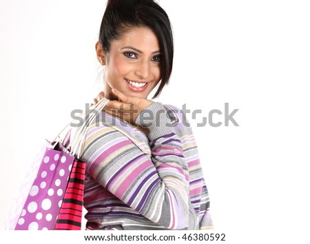 smiling teenage girl with shopping bags - stock photo