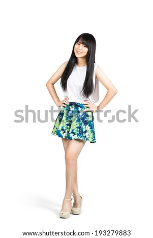 Smiling teenager asian girl standing, Isolated over white - stock photo
