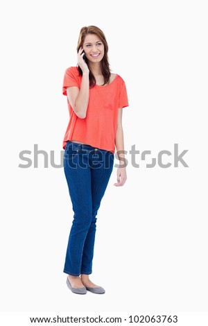 Smiling teenager communicating on the phone - stock photo