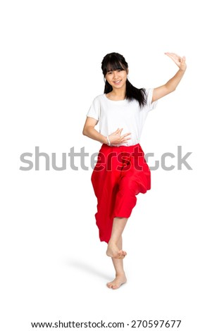 Smiling teenager girl dancing with thai style, Isolated over white - stock photo
