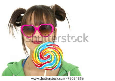 Smiling teenager holding a candies full of colors - stock photo