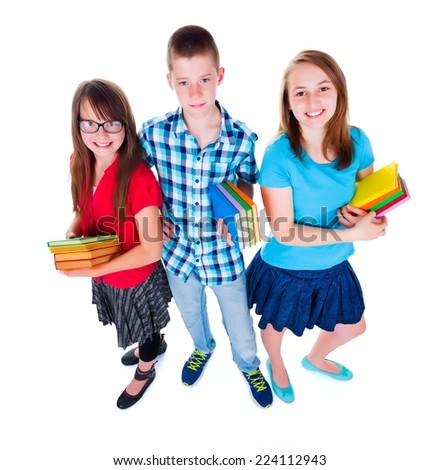 Smiling teens looking up while holding colorful books. Wide angle shot - stock photo