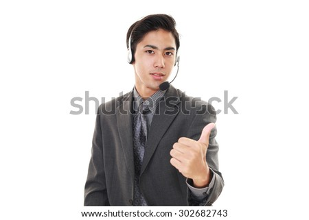 Smiling telephone operator - stock photo