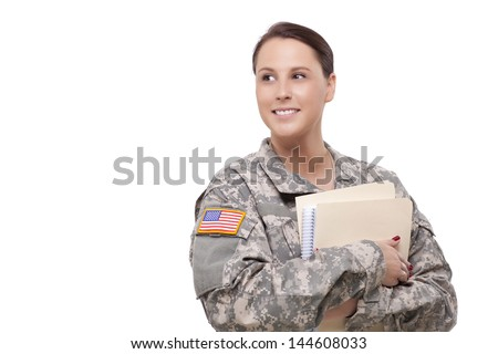 Smiling U.S. female soldier with folder looking away  - stock photo