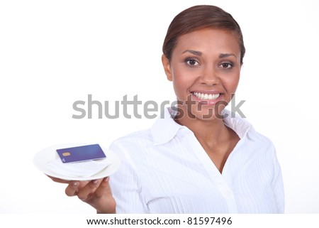 Smiling waitress with the bill and a credit card - stock photo