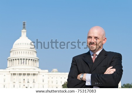 Smiling white man looking at the camera.  He's a lobbyist standing outside the U.S. Capitol in Washington DC, United States. - stock photo