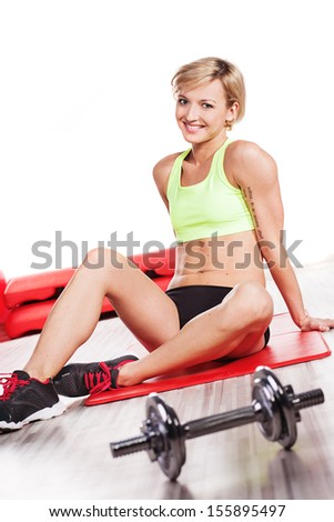 Smiling woman at gym - stock photo