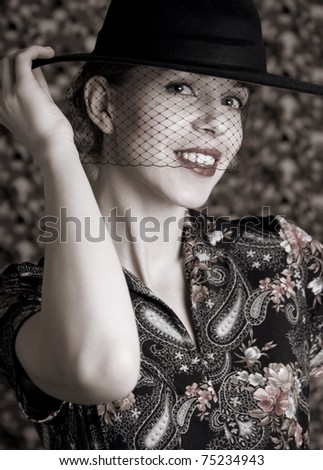 Smiling woman at hat - stock photo