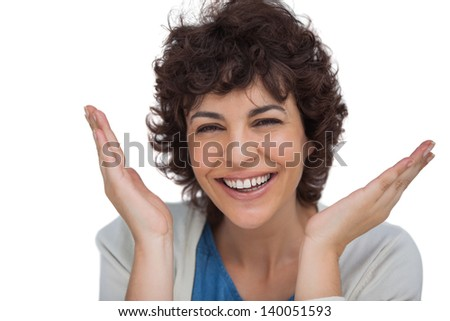 Smiling woman being surprised on white background - stock photo