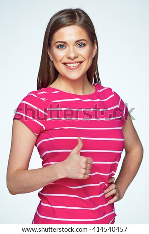 Smiling woman casual dressed show thumb up. White background isolated portrait. - stock photo