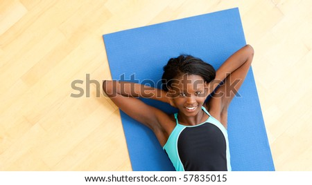 Smiling woman doing fitness in gym - stock photo