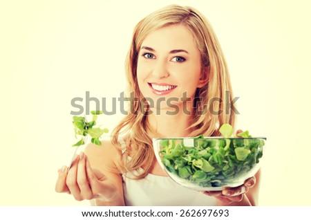 Smiling woman eating healthy salat - stock photo