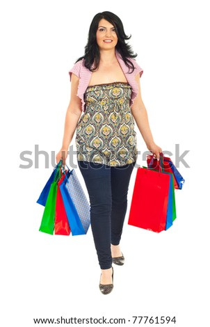 Smiling woman going to shop and holding shopping bags isolated on white background - stock photo