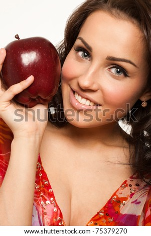 Smiling woman holding big red apple in hand - stock photo