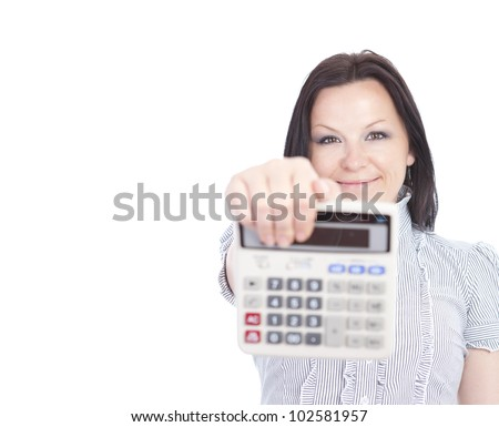smiling woman holding calculator over white background - stock photo