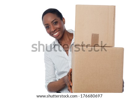 Smiling woman holding cardboard boxes for shipment - stock photo