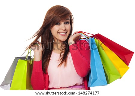 Smiling woman holding shopping bags - stock photo