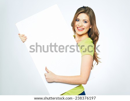 smiling woman holding white  sign board. portrait of smiling young model with long hair. isolated girl portrait. - stock photo
