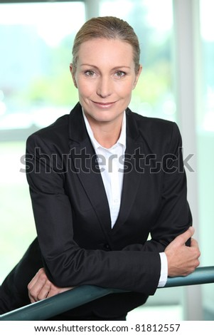 Smiling woman in a suit - stock photo