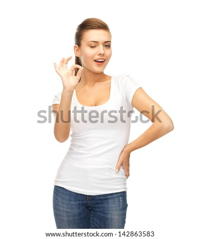 smiling woman in blank white t-shirt showing ok gesture - stock photo