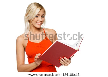 Smiling woman in bright red dress reading a book over white background - stock photo