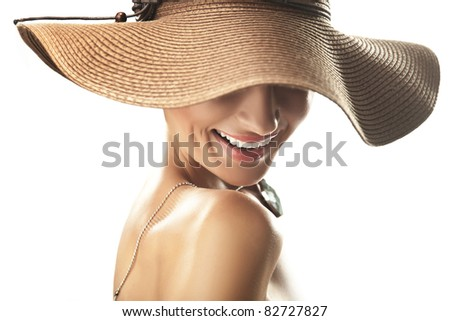 Smiling woman in hat - stock photo