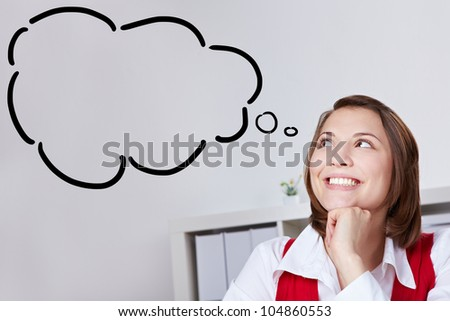 Smiling woman in offce with thought bubble looking up - stock photo