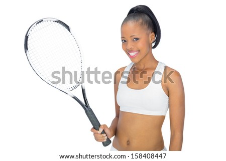 Smiling woman in sportswear holding tennis racket against white background - stock photo