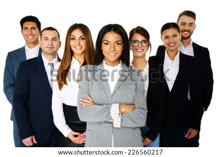 Smiling woman leading her happy team over white background - stock photo