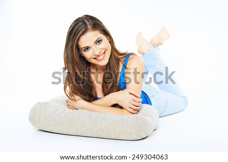 Smiling woman lying on a floor lean on arms. Young female model full body portrait isolated on white background. - stock photo
